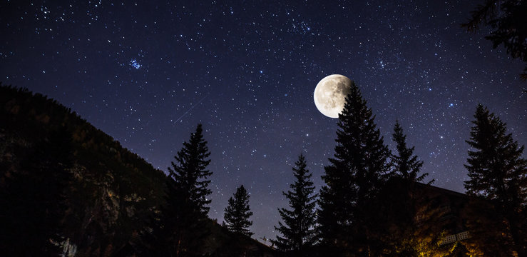 Starry sky and full moon over the Alps, Italy