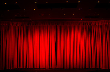 The moment of excitement and anticipation in the darkened theatre or cinema waiting for the curtain to go up Fotomurales