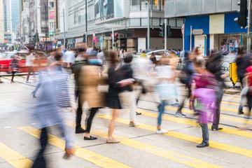 pedestrian crossing in busy city, people walking,  blur