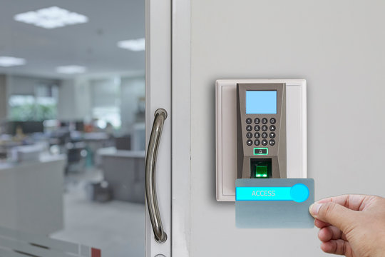 Fingerprint scan machine systems for access interior installed on bricks wall in front of blur office background. Selective Focus.