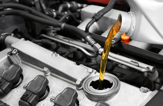 Synthetic motor oil pouring, fresh motor oil