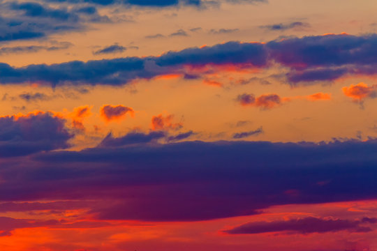 orange sunset sky with clouds. beautiful nature background