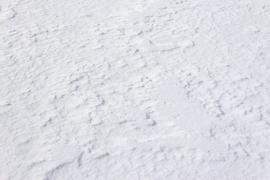 natural snow white texture. bright winter background. cold frosty weather condition. shining and glittering particles