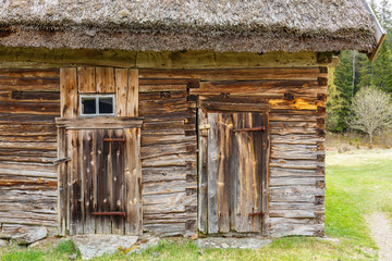 Wall Mural - Old weathered timber barn with a thatched roof