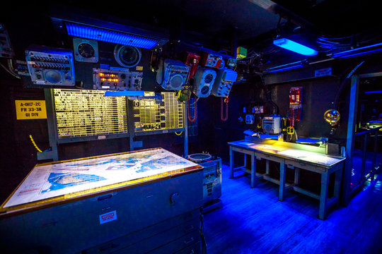 San Diego, Navy Pier, California, USA - JULY 31, 2018: dark war room with battle stations and instruments, consoles of Battleship Midway at San Diego. Popular tourist attraction in the city.
