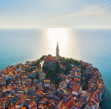 Beautiful Rovinj at sunset. Evening aerial photo of the old town of Rovinj with church of St. Euphemia, Istria, Croatia