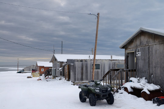 ATV and snowman on Eskimo village street of Kaktovik Alaska on the Arctic Ocean
