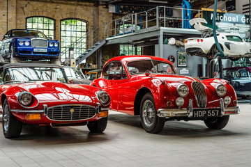 """BERLIN - MAY 13, 2017: Car workshop for maintenance of classic British car. Center of competence for classic cars and youngtimers - Classic Remise. Exhibition """"Oldtimertage Berlin-Brandenburg"""""""