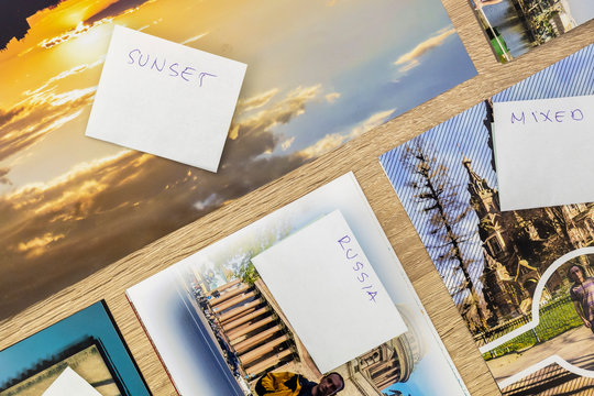 Printed Image Collections With Paper Sticker on Wooden Background