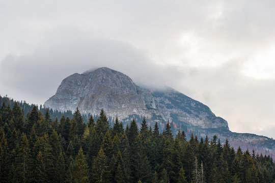 Bobotov kuk mountain in clouds surrounded by forest. Autumn in Montenegro, Black lake.