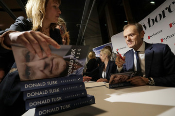 """Donald Tusk, a Polish politician and former European Council President, signs a book during a promotion of his personal diary, """"Szczerze"""" (Sincerely) in Warsaw"""