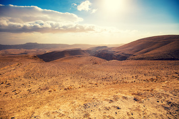 Mountainous desert with a beautiful cloudy sky. Desert in Israel at sunset Wall mural