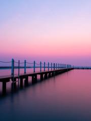Fototapeten Flieder Wooden pier around Narrabeen rock pool in the morning, Sydney, Australia.