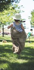 Girl running in a Potato Sack