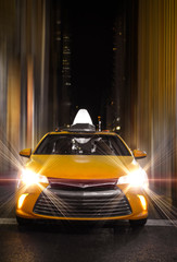 Urban Night Closeup Of New York City Yellow Cab Taxi In Slick Lighting