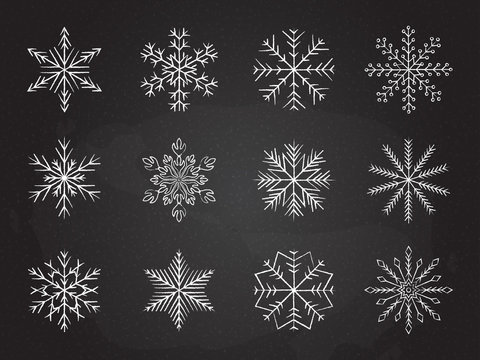 Icy snowflakes winter decoration collection vector illustration. Set of chalk sketch white snowflake icons on blackboard for new year celebration design or winter season festive ornament decoration