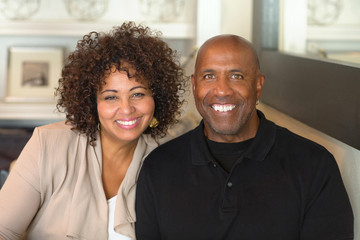 Portrait of a mature mixed race couple smiling.
