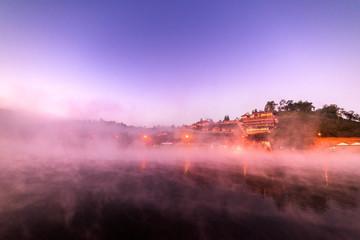 Fototapeten Flieder Lake view misty morning Ban Rak Thai Reservoir, Mae Hong Son