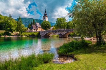 Wall Mural - Beautiful alpine village with traditional church, Lake Bohinj, Slovenia, Europe