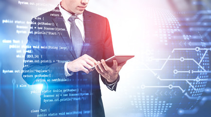 Man with tablet, programming concept Wall mural
