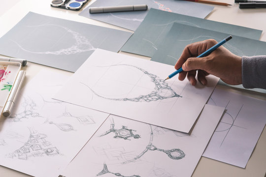 Designer design diamond jewelry drawing sketches making works craft unique handmade luxury necklaces product ideas.