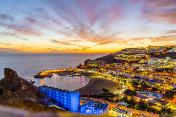 Wall Mural - Landscape with Puerto Rico village at twilight time, Gran Canaria island, Spain