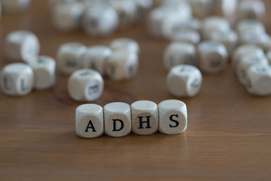 Adhs in german written with wooden cubes