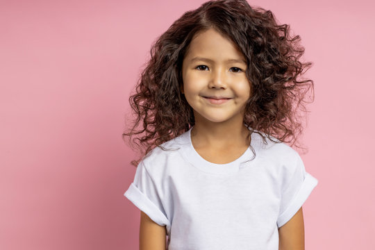 Portrait of a pretty curly little girl