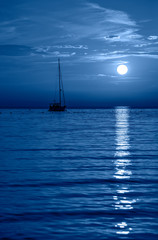Beautiful night Adriatic sea, yacht and full moon, Croatia. Night seascape.