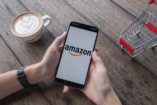 CHIANG MAI,THAILAND - May 11, 2019 : Oneplus 6 showing Amazon logo to shopping online. Amazon.com, Inc. American international electronic commerce company.