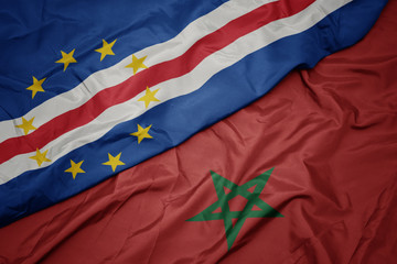 Foto auf Acrylglas Kastanienbraun waving colorful flag of morocco and national flag of cape verde.
