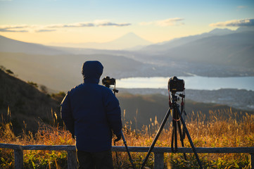 Outdoors photographer photographs Mt.Fuji in morning