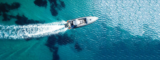 Foto auf AluDibond Fischerei Aerial drone ultra wide top down photo of luxury rigid inflatable speed boat cruising in high speed in Aegean deep blue sea, Greece