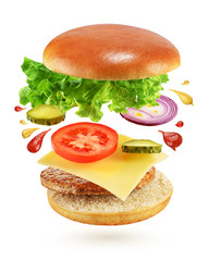 Flying burger isolated on white background