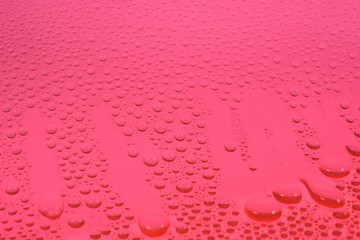 water drops on a red surface