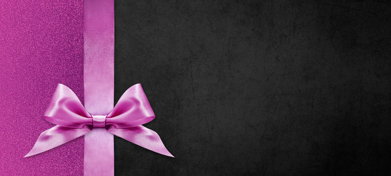 gift cards with pink ribbon bow Isolated on pink and black texture background, christmas and black friday template with copy space