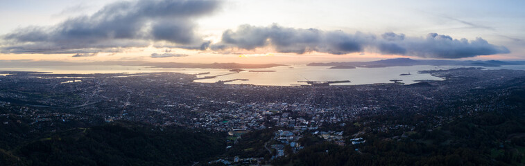 A serene sunset illuminates the San Francisco Bay area including Oakland, Berkeley, Emeryville, El Cerrito, and San Francisco in the distance.