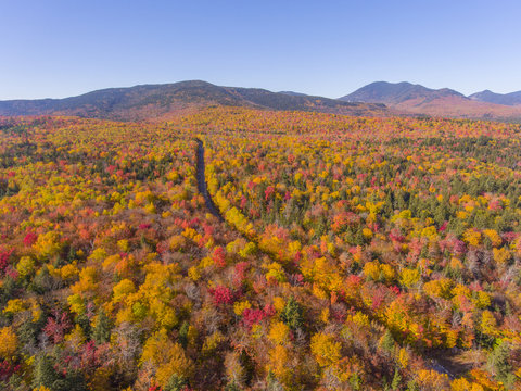 White Mountain National Forest fall foliage on Kancamagus Highway aerial view near Sugar Hill Scenic Vista, Town of Lincoln, New Hampshire NH, USA.