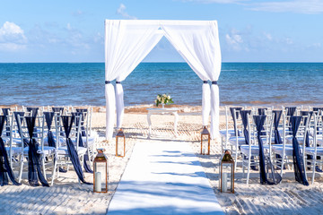 Blue themed wedding setup at the white sandy beach. Romantic getaway wedding. Horizontal