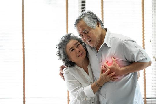 Asian Senior man having heart attack.