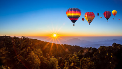 Poster Ballon Colorful hot air balloons flying over mountain at Dot Inthanon in Chiang Mai, Thailand.