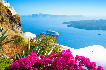 Fotobehang Santorini White architecture and blue sea on Santorini island, Greece. Summer holidays, travel destinations concept