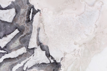 Contrast marble background with perfect surface in grey tone.