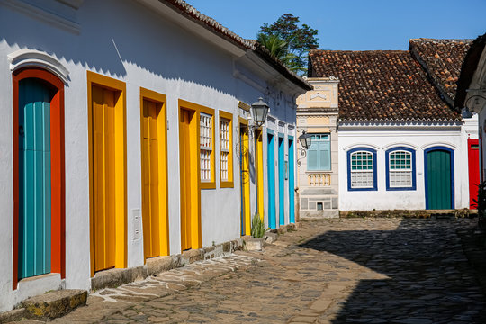 Typical cobblestone street with colorful colonial buildings in the late afternoon sun in historic town Paraty, Brazil