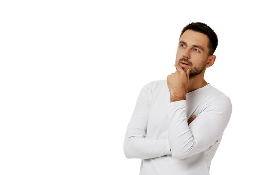 portrait of doubtful bearded man in casual white shirt asking questions isolated on white background. copy space