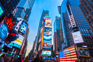 NEW YORK CITY, USA - DECEMBER 01, 2013: Times Square,is a busy tourist intersection of neon art and commerce and is an iconic street of New York City and America.
