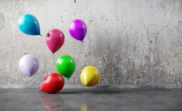 Colorful balloons floating on grunge wall