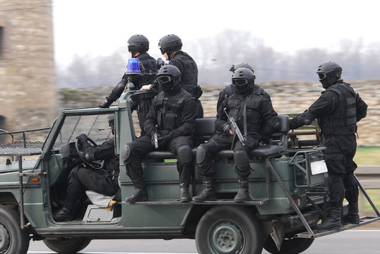 Military soldiers transporting in the military truck, unrecognizable people