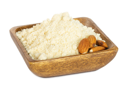 Almond flour in wooden bowl isolated on white