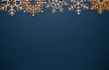 Flat lay Christmas background with hand made wooden snowlake toys